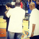 Michael Jordan and Fred Whitfield checking out the back of the shirt