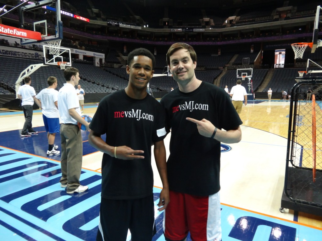 Me with one of the young people I mentor, Carlyle Holder, at the Charlotte Bobcats Fantasy Camp